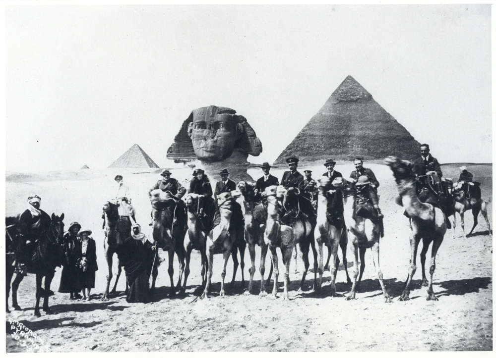 Photograph of Gertrude Bell in front of a pyramid and sphinx